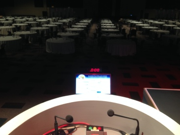 Speaker technology at work in a plenary room for 1,200 people with comfort monitor, count down timer and timer lights.